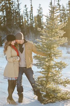 Romantic Couple Christmas Tree Farm Photo Session Idea / Engagement Photography / Pose Ideas / Winter Photoshoot