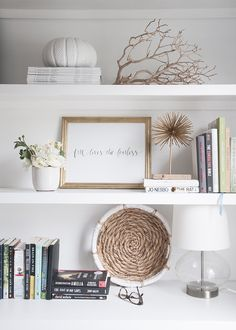 Think outside the books and take some pointers from Earnest Home co on best ways to make your bookcase a decorative showstopper. Add a glass lamp base and small decor accents to give your shelves a unique look. www.earnesthomeco...