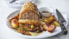 Roasted pork scotch fillet with burnt honey and grilled peaches