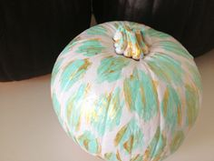 Who says you have to stick to black and orange? This no-carve pumpkin decoration features pastel-colored leopard spots.