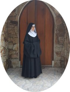 Benedictine Nun wearing a Cuculla, This garment is worn by nuns when they profess their final vows. It is worn at Choir, Chapter, and during other religious ceremonies. Nun Outfit, Benedictine Monks, Religion, Religious Ceremony, Choir, Storyboard, Vows, Sisters, Spirituality