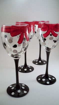 There is a bright red bow wrapped around the top of each glass with black and white polka dots below. Description from etsy.com. I searched for this on bing.com/images