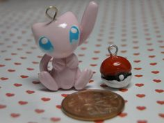 Polymer Clay Pokemon Mew Charm by sanxcharms   Less than an inch tall polymer Pokemon Mew chibi charm, Hand sculpted out of polymer clay, Face painted on with acrylic paint and Glazed with a varathane varnish