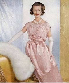 1956 Mary Jane Russell in pale pink satin gown embroidered in brilliants by Leslie Morris, jewelry by Van Cleef & Arpels, photo by Henry Clarke, Vogue, September.