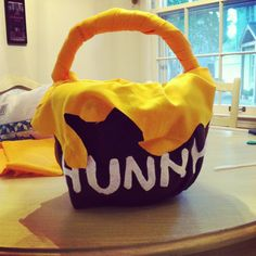 """""""Hunny"""" pot candy bucket for Winnie the Pooh costume - plastic pumpkin bucket, fabric/felt, spray adhesive, quilt batting, and hot glue Book Costumes, Book Character Costumes, Disney Costumes, Costumes 2015, Costume Ideas, Halloween Costumes, Winnie The Pooh Costume, Winnie The Pooh Birthday, Winnie The Pooh Honey"""