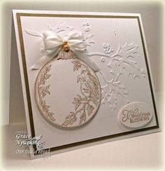 elegant white Christmas card with gold embossed bauble and sentiment...beautiful!!!