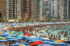 Fancy a dip? Huge crowds have been seen on Levante Beach in Benidorm. More than 29 million descended on Spain in the six months to June - 4.2 per cent more than the same period in 2014