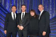 """MAY 14, 2015 (L-R) Assistant Vice President, Film/TV Relations at BMI Ray Yee, composer Fil Eisler, BMI Vice President of Film and Television Relations Doreen Ringer-Ross and BMI President and CEO Mike O'Neill pose with the BMI Film Music Award for """"Empire"""" onstage during the 2015 BMI Film & Television Awards at the Beverly Wilshire Hotel on May 13, 2015 in Beverly Hills, California. (Photo by Lester Cohen/Getty Images for BMI)"""