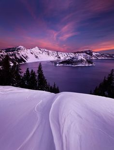 Winter Sunset at Crater Lake National Park in #Oregon. Visit our website: www.tourguidemostar.com #travel #photography #travelworld #traveler #landscape #snow #winter #wintertime #tourguidemostar