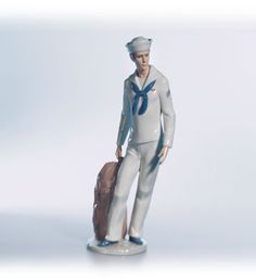 Lladro 06654 On shore leave - got this one several years ago, it was amazing how much it looked like my husband (a sailor too!)