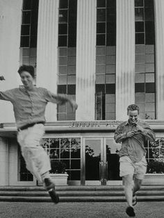 Wes Anderson jumps for joy with Own Wilson after signing a deal to make his first film 'Bottle Rocket.'
