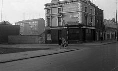 Photo is of Lowry's Pub, Summerhill. In the background is the Clarence St flats. Old Pictures, Old Photos, Photo Engraving, Local History, Dublin Ireland, Street View, Paintings, Flats, Loafers & Slip Ons