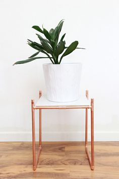 Balance a marble tile on a copper pipe frame for a pretty plant stand. | 33 Gorgeous DIY Projects To Decorate Your Grown Up Apartment
