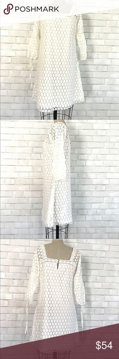 Boho mini white lace dress sizeL Boho chic 3/4 sleeve lace white mini dress  Size L, runs more like a Medium size, lace 65% Cotton 35% Polyester, full polyester underlining. 3/4 tie sleeves. Dress is in new condition worn one time.   Ⓜ️Chest 38 Ⓜ️Waist 36 Ⓜ️Sleeves 16 Ⓜ️Length 36  ✅Bundle and save  ✅🚭 🚫No Trading 🙅🏻 Poshmark rules only‼️ solitaire by Ravikholsa Dresses Mini