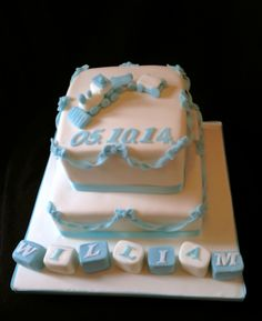 Blue blow and block christening cake
