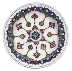 An Iznik polychrome pottery dish, Turkey, circa of shallow round form… Pottery Plates, Ceramic Pottery, Pottery Art, Islamic World, Islamic Art, Turkish Tiles, Turkish Decor, Plate Art, Pottery Making