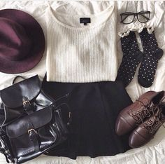 Cream sweater, black skater skirt, leather backpack, polkadot black and white, brown combat boots, black glasses, and burgundy hat