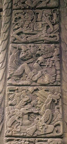 Maya Hieroglyphs are carved on the side of a tall stela at the site of Quirigua Guatemala