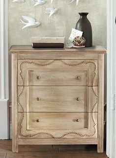 Add a touch of vintage grace to your home with the handsome Kira Chest that features an ogee nailhead trim, brass pulls and three generous drawers for storage.