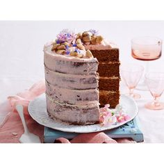 This pretty four-layer caramel mud cake is sure to impress. It's easy to make too! Layer & decorate with pink butter cream & edible flowers for a stunning centrepiece.