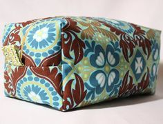 The next time you travel you can skip carrying a handful of smaller bags to cart your cosmetics in and create one big carrier. This Boxy DIY Cosmetic Bag is roomy enough to hold all of your make-up and other cosmetics.