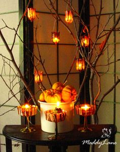 Fall decor with pumpkins, branches and hanging votives