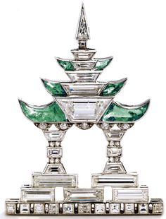 Diamond and emerald Pagoda brooch, Janesich, circa 1925. Designed as a pagoda with stylized columns and upturned eaves, set with baguette, square-shaped, trapeze-cut, triangular-shaped, single-cut and rose-cut diamonds weighing approximately 3.00 carats, accented with 6 calibré-cut buff-top emeralds, mounted in platinum, signed JANESICH, numbered 10124. Via Sotheby's.