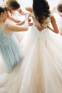 Slipping into your wedding gown is no easy feat. Capture your team in action helping you put on your dream dress. You might want to get your mom in on this one, too.Related:Magical Photos of Parents Seeing Their Daughter As a Bride For the First Time