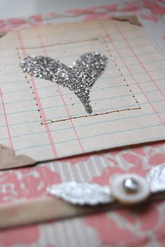 glitter heart on ledger paper