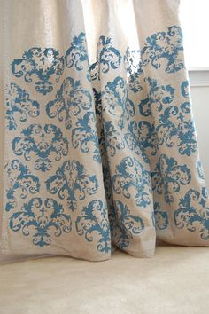 Stenciled Drop Cloth Curtains... plus other great tutorials on the blog.