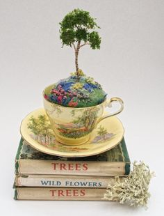 """3D machine embroidered Silver Birch tree sitting in hand embroidered grassy landscape base.  In a vintage Aynsley """"Bluebell Time"""" tea cup. For sale on my website."""