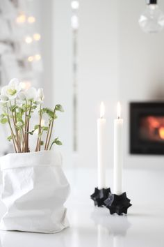 gorgeous Christmas styling by elisabeth heier: S T R Å L A N D E J U L Does anyone know where the bag planter is from please? Noel Christmas, Scandinavian Christmas, Little Christmas, Christmas Colors, Winter Christmas, Christmas Candles, Decoration Christmas, Holiday Decor, Deco Floral