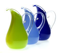 Opaque Curly Pitchers by Cal Breed. Opaque blown glass glass pitcher with clear handle. Signed on bottom.