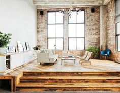 Love the exposed bricks, contemporary furniture and love the angled wood floor.