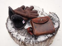 by Hollows Leather. Excellent little leather pouch.