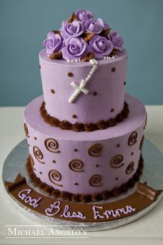 "Purple & Brown Swirls #27Religious This purple and brown religious design is popular because the swirls and polka dots add a little touch of fun to a very special occasion. The cluster of matching buttercream roses make a great topper and the rosary adds that extra ""religious"" appeal."