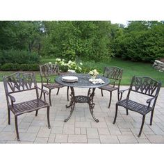 Oakland Living Mississippi Cast Aluminum 42 in. Tulip Patio Dining Set by Oakland Living Corp. $1799.99. The Oakland Living Mississippi Cast Aluminum 42 in. Tulip Patio Dining Set has it all - Southern styling, modern aesthetics, and practical function. The comfortable, traditional lattice seat is offset by the casual appeal of the tulip-pattern backrest, creating a set that's just the right size for any small backyard or patio. The 42-inch-diameter table sports an umbre...
