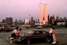 """Downtown Manhattan with World Trade Center towers, seen from """"lover's lane"""" in New Jersey, 1983 by Thomas Hoepker."""