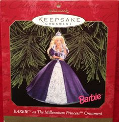1999 Barbie as The Millennium Princess Ornament - On behalf of everyone who loves beautiful fashions, Barbie presides over the festivities at the gala 1999 New Year's Eve ball. To the delight of the guests and her royal court, Barbie makes a grand entrance as The Millennium Princess. She wears an elegant formal gown of midnight blue, accented by beautiful jewelry and a sparkling crown. She carries a crystal ball that symbolizes the beginning of the new year and the new century.