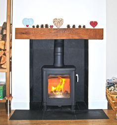 Natural slate tiled chamber and hearth with reclaimed clad oak beam and Contura wood stove fitted in Rayleigh Essex Fireplace Tile, Wood, Diy Fireplace, Fireplace Design, Wood Stove, Wood Burner Fireplace, Traditional Fireplace, Fireplace, Slate Hearth