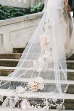 We're not sure what we love most about this dynamic chapel-length veil: It's romantic 3D dahlia appliqués, it's bow-tied edges, or the romantic vine motif embroidered around the edges. The accessory perfectly complemented the bride's lace Claire Pettibone wedding dress. #weddingideas #wedding #marthstewartwedding #weddingplanning #weddingchecklist Wedding Veils, Rose Wedding, Bridal Veils, Garden Wedding, Forest Wedding, Wedding Hair, Floral Wedding, Chapel Length Veil, Spring Wedding Inspiration