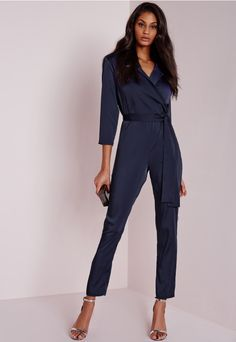 Oh so chic and ever stylish, this elegant blue satin jumpsuit should be a staple of every girls wardrobe. Featuring a wrap front V neck, tie waist and shirt style top, pair this timeless piece with barely there heels and a box bag for effor...