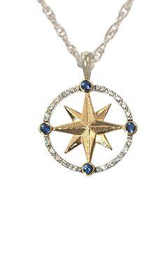Outlined in sparkling diamonds (10 pts. tw) and four blue sapphires marking the four directions, the stones are set in a circle of 14K white gold with a center of 14K yellow gold. The rope chain of 14