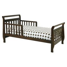 Toddler Bed: DaVinci Sleigh Toddler Bed - Dark Brown (Espresso) (048517801581) The davinci sleigh toddler bed offers a comfortable sleeping space for your little one. It has guardrails on both sides to keep him or her safe while sleeping. This kids' furniture is built on a solid pine frame for durability. Its stained espresso finish seamlessly accentuates your child's room décor. This wooden toddler bed has a slatted design and curved details. It holds up to 50 lbs. Ages 2 and up.