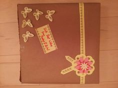Gift wrap using punched paper flowers