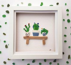 Sea glass art cactus. This sea glass art is a gorgeous and unique handmade pebble art picture of three sea glass succulent plants in beautiful sea pottery plant pots sitting on a driftwood bench. This home decor sea glass picture is stunning and would make a perfect and unique gift as a