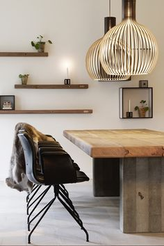 Clean lines and solid timber || Love the way the pendant lights add curves to this modern space and create inviting patterns