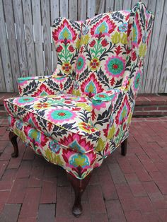 love a bright patterned chair...i dont even care if it matches anything