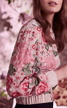This **Needle & Thread** Rose Beige Floral Embroidered Bomber Jacket features allover floral embroidery with an elastic waist and cuffs.