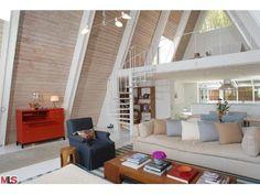 glass/acrylic on loft area, slats between angled beams